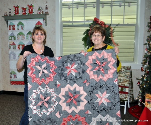 Jennifer and Karla with quilt featuring Mama Said Sew fabric