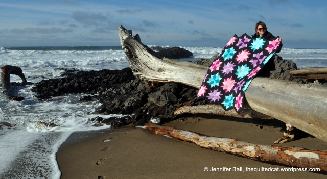 Me holding the quilt in the wind!