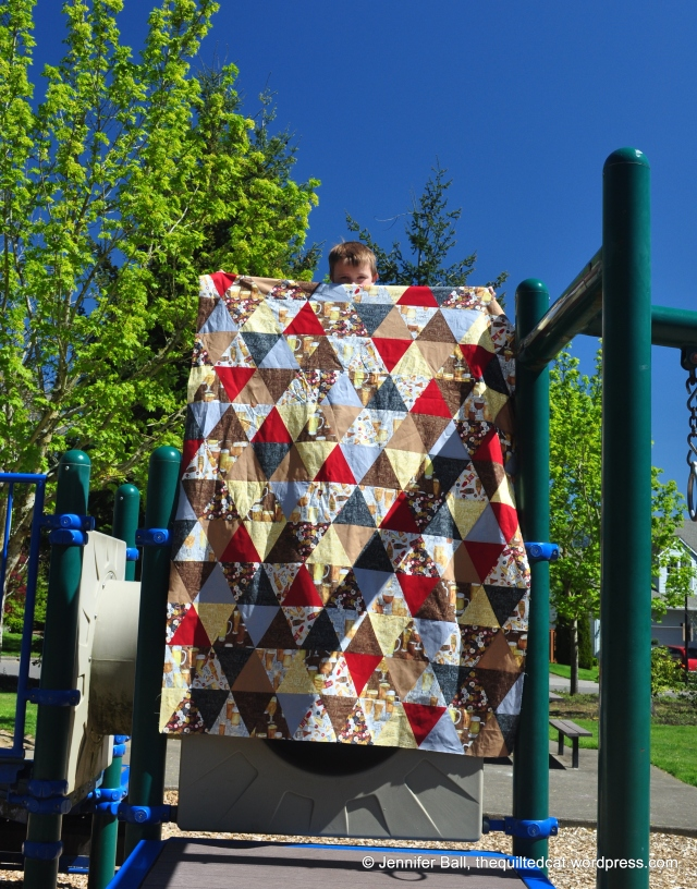 Triangle QAL Quilt Top on Play Structure? Almost!