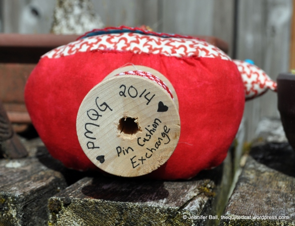 Bottom of Wooden Spool on Bird Pin Cushion
