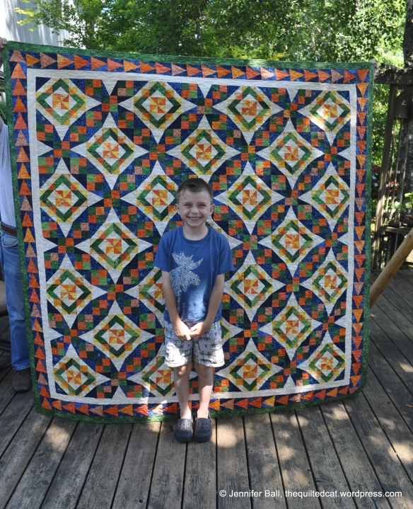 Ian standing in front of my finished Celtic Solstice quilt