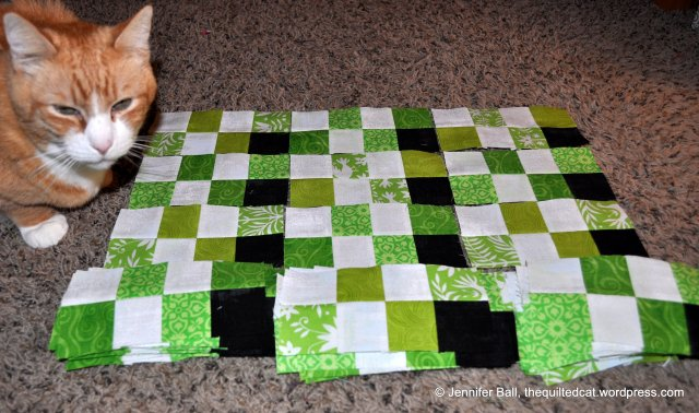 Greens in part 3 of the Grand Illusion Mystery quilt!