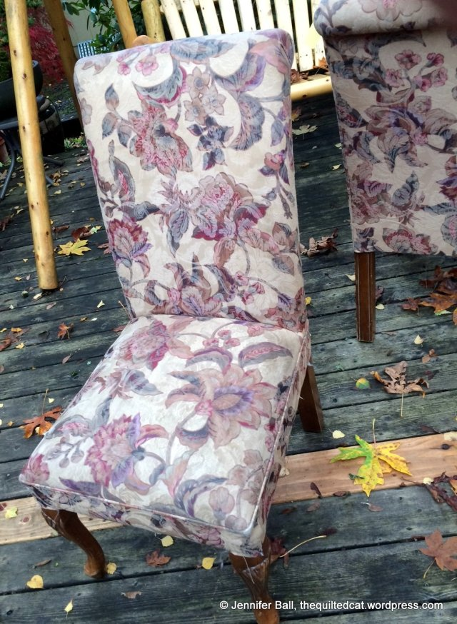 Close-up of worn and dated upholstery