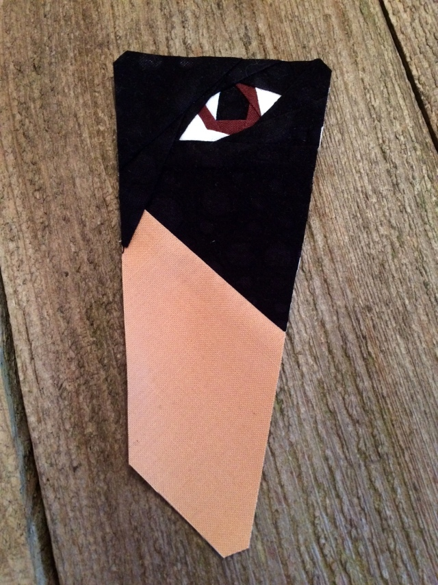 Detail of dog eye; foundation paper-pieced