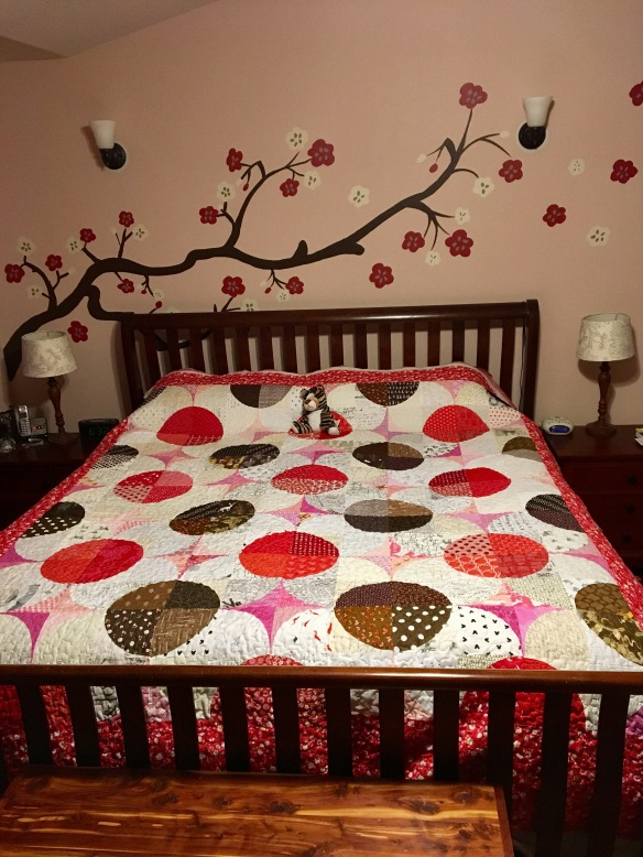 Cherry Blossom quilt on a king-size bed