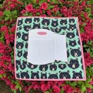 Completed Keep Calm and Roll On mini quilt on a beautiful azalea